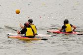 In kayak playing polo — Stock Photo