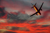 Air travel - plane and sunset — Foto Stock