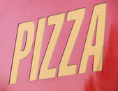Pizzeria: pizza inscription over red — Stockfoto