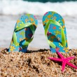 Flip flops at the beach — Stok fotoğraf