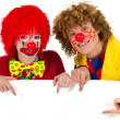 Funny clowns with white board — Stock Photo