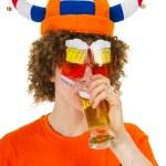 Dutch sports fan is drinking beer — Stock Photo #5739602