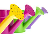 Colorful watering cans — Stock Photo
