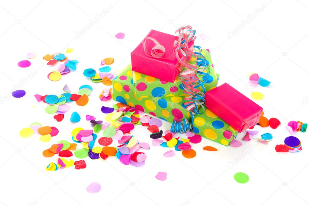 Wrapped birthday presents with colorful paper confetti  Stock Photo #6014540
