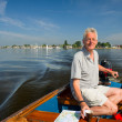 Elderly man in boat — Stock Photo