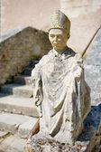 Old sculpture of Benedictine munch — Stock Photo