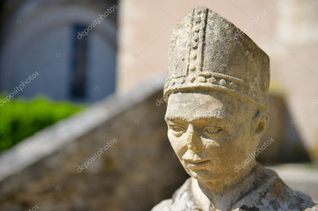 Old French sculpture of a Benedictine munch at the abbey in Tourtoirac  Stock Photo #6379783