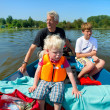 Grandfather with grandchildren on the water — Stock Photo
