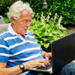 Senior man with laptop — Stock Photo