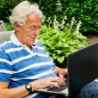 Senior man with laptop — Stock Photo #6420210
