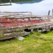 Rotten wooden row boat - Stock Photo