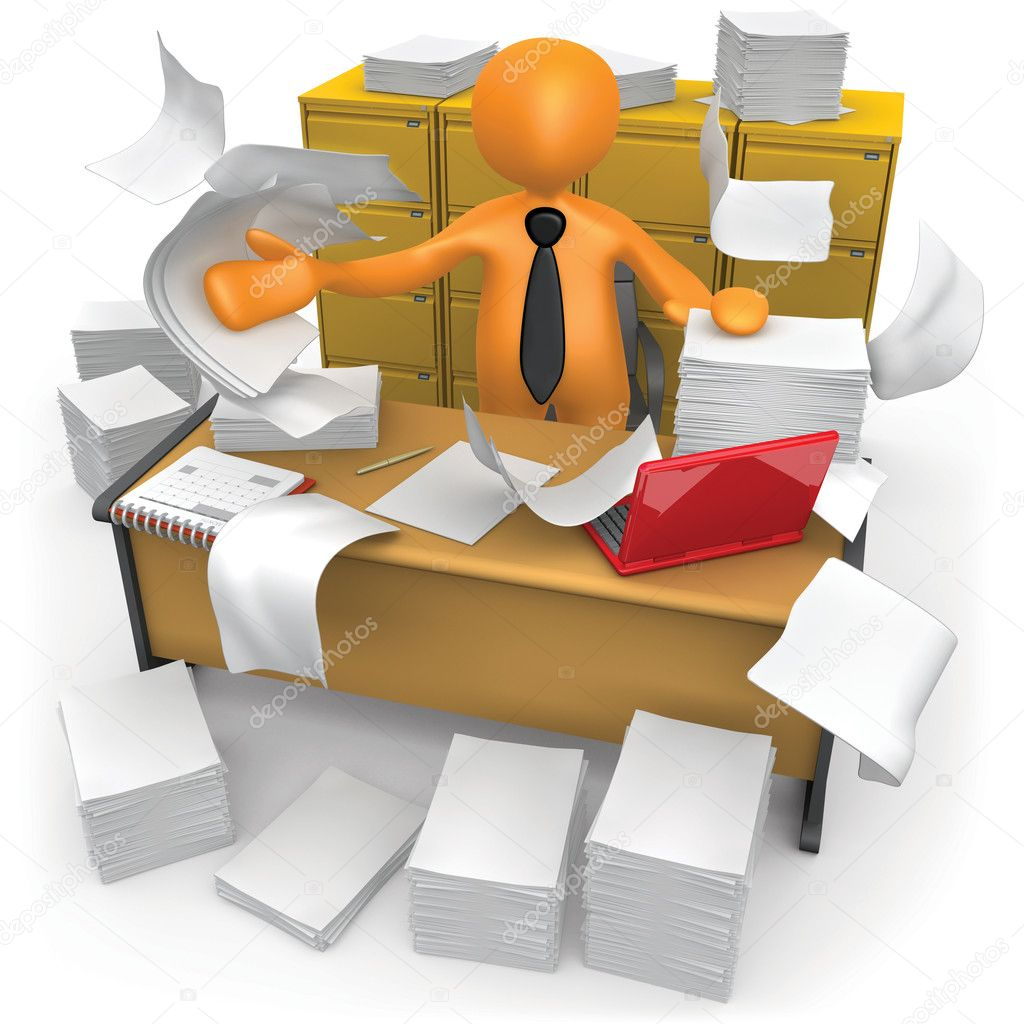 Businessman trying to make some space on his messy office.  Stock Photo #5944109