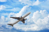 Airplane in cloudsape — Stock Photo