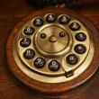 The old desk's phone dial disc — Stock Photo