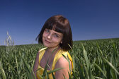 Young girl on a meadow. — Stock Photo