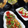 Appetizers with drinks for guests — Stock Photo