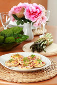 Small cheesy cakes as appetizer — Stock Photo
