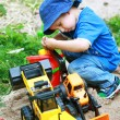 Boy playing with digger - Foto Stock