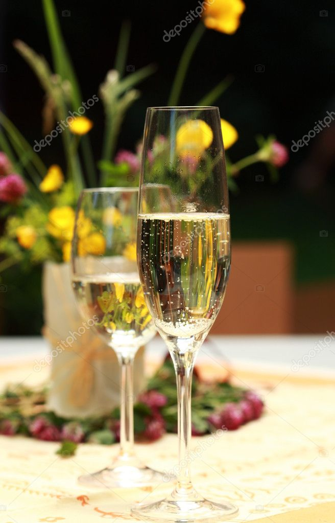 Two glasses of champagne in outdoor restaurant — Stock Photo #5846453