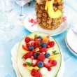 Fresh fruit salad with pineapple drink — Stock Photo