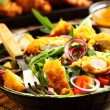 图库照片: Gourmet salad with curry chicken stripes