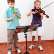 Kids playing flute and violin — Foto de Stock