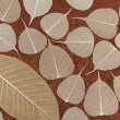 Skeletal leaves over brown handmade paper - background — Stock Photo