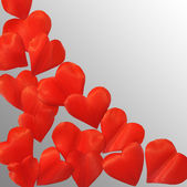 Petals in heart shape over gray background - frame. Clipping path included — Stock Photo