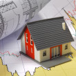 Model house on blueprint — Stock Photo