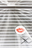 Bathroom blinds and mirror with lipstick — Stock Photo