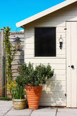 Garden shed and plants in spring — Stock Photo