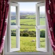 Open window with view across countryside - Stok fotoğraf