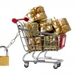 Secure shopping trolley with presents — Stock Photo