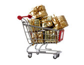 Shopping trolley with presents isolated — Stock Photo