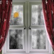 Rain on a window with curtains — Stock Photo