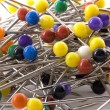 Pile of colourful pins on white background — Stock Photo