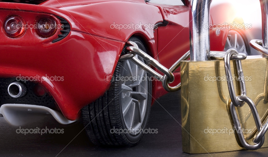 Car chained with padlock close up and sun light — Stock Photo #6145072