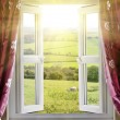 Open window with countryside view and sunlight — Stock Photo