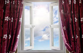 Modern window open with a view to sky and sun — Stock Photo