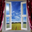Window view onto arable farmland and blue skies — Stock Photo #6555940