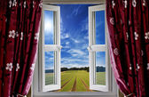 Window view onto arable farmland and blue skies — Stock Photo