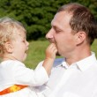 Baby girl in fathers arms — Stock Photo