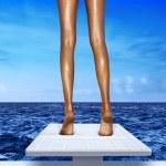 Legs on springboard — Stock Photo #5545291