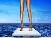 Legs on springboard — Stock Photo