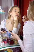 Beautiful woman in dressing room — Stock Photo