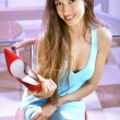 Shopaholic with red shoe — Stock Photo #6540282