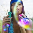 Woman blowing soap bubble — Stock Photo #6540302