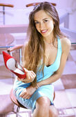 Shopaholic with red shoe — Stock Photo