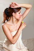 Woman applying antiperspirant — Stock Photo
