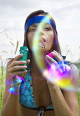 Woman blowing soap bubble — Stock Photo